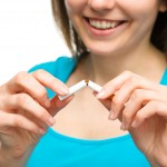 Young woman is breaking a cigarette, quit smoking concept, isola